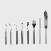 Instrumento de esculpido para cera dental