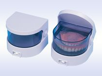 Limpiador de prótesis dentales