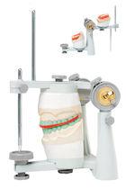 Articulador dental arcón
