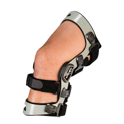 Inmovilización ortopédica órtesis de rodilla / estabilización de los ligamentos de la rodilla / articulada / dinámica Axiom® Elite  Breg