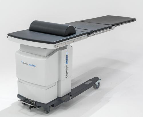 mesa de exploración para urología / eléctrica / de altura variable / con ruedas